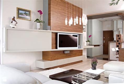 Charmant Meuble Cache Tv Electrique #5: ecran-plat-mural-meuble-bois-porte-coulissante-salon-mobilier-blanc.jpg