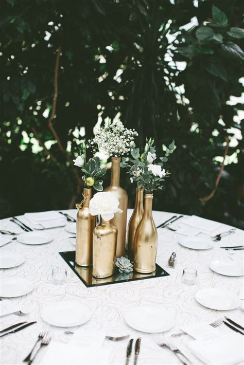 Gold centerpiece. Gold spray painted bottles. Wedding
