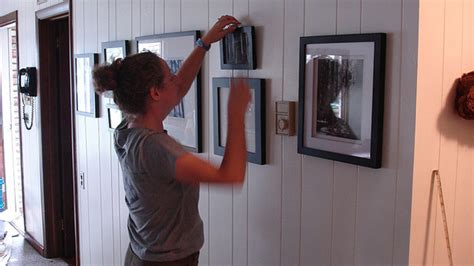 how to hang a painting how to hang pictures without destroying your walls