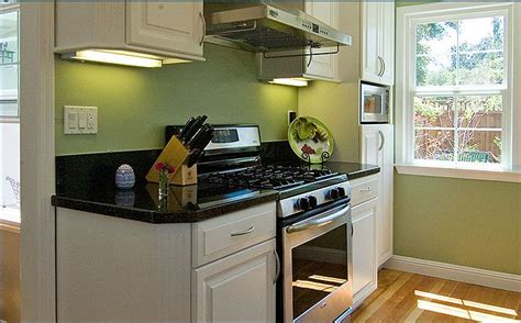 green kitchen design ideas small kitchen design ideas green wall white windows white counters white cabinets kvriver