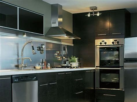 kitchen ideas with stainless steel backsplash smith design kitchen with black cabinets and stainless steel backsplash