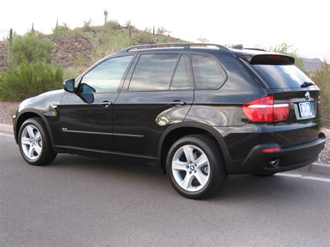 bmw board any side by side pics of x5 with and without running