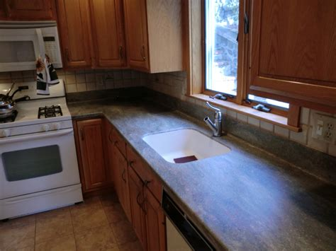 apex kitchen cabinet and granite countertop decorating beautiful brown wooden cabinet with corian vs