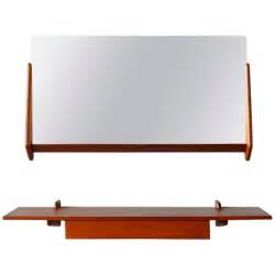 vintage teak mirror and floating shelf attributed to aksel