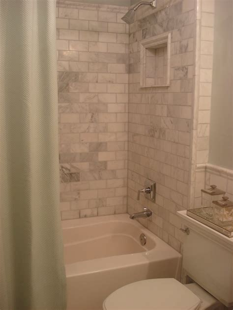 marble and subway tile bathroom if i could do it again