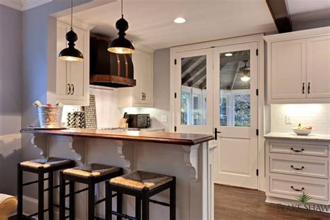 counter between kitchen and living room seagrass counter stools transitional kitchen shaw homes