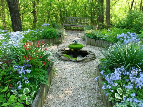 circular raised garden beds with a seat and central fountain in ny formal lines combined