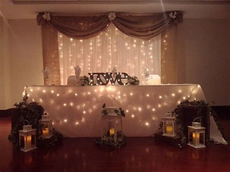Rustic backdrop and head table decor by Boutique Linen