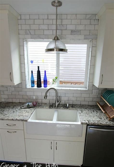 tile around kitchen window how to lay backsplash around kitchen pass through