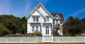 House With Porch living the american dream with a white picket fence