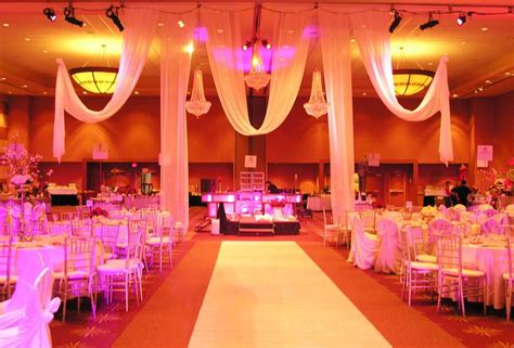 white swag hanging from the ceiling with pink lighting formal events s day