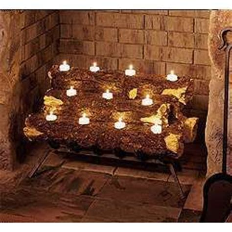 Fireplace Log Candle Holder by 25 Best Ideas About Fireplace Filler On Faux