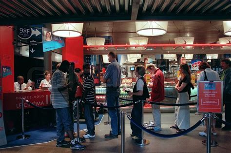 Home Cinema Interior Design People Standing In A Line For Movie Tickets Stock Photo