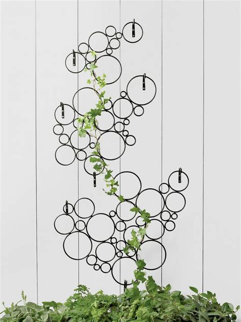 metal garden wall trellis these metal garden trellises are beautiful with or without plants
