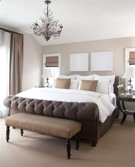 beautiful bedroom with clay beige walls paint color chocolate brown tufted sleigh eloise bed