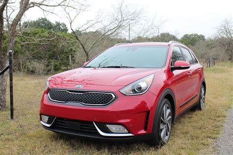 everyone s guide to buying a used car and car maintenance books all electric kia niro ev to come in 2018 says kia exec
