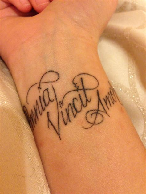 love conquers all tattoo designs quot omnia vincit quot wrist conquers all in