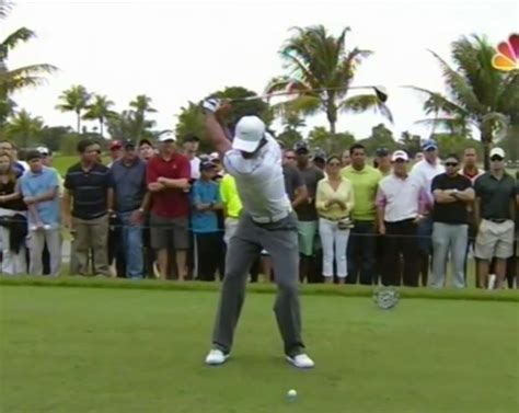 slow motion golf swing from behind tiger woods golf swing video 2013 face on view 300fps
