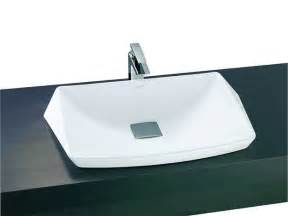 White bathroom sink on black countertop sink repeating expensive