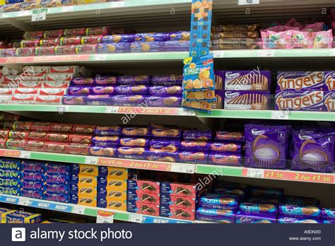 Shelf Shopping by Chocolate Biscuits Stacked On Supermarket Shelves Stock