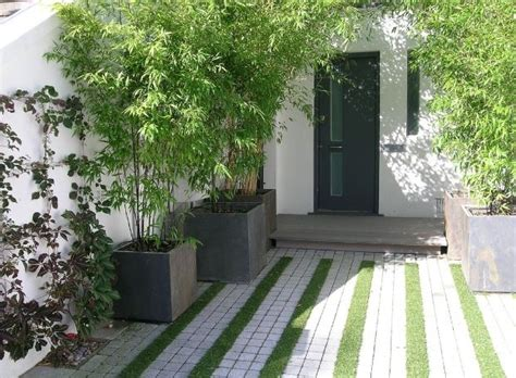 Driveway Entrance Planters by Driveway With Grass Stripes Materials
