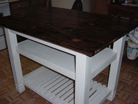 kitchen island table with basket shelf just fine tables 3 x 4 handmade pine top kitchen island with two shelves
