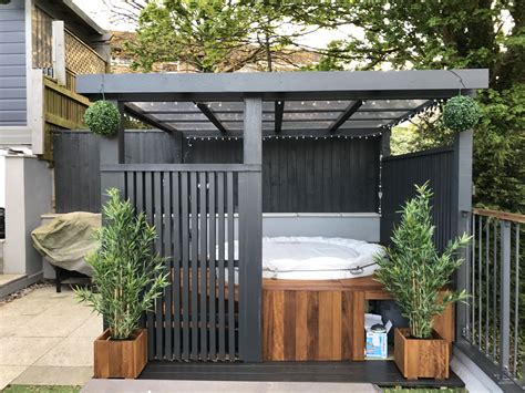 modern grey pergola lazy spa tub iroko surround