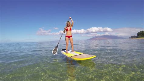 boat paddle definition sexy fit beach girl woman on sup stand up paddle board