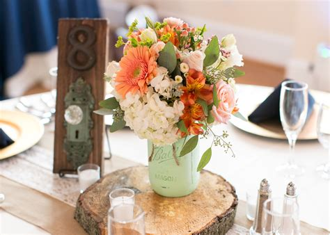 wood centerpiece wood slab centerpieces with mint jars and doorknob table numbers