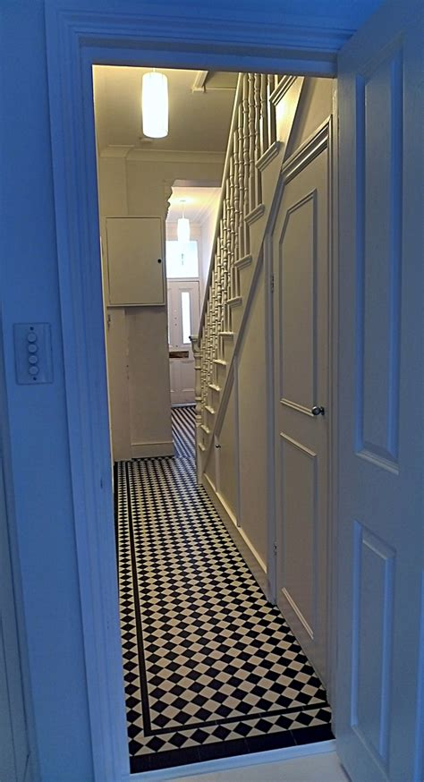 hallway black  white victorian mosaic tile path london