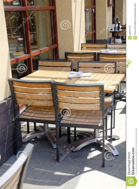 wooden tables  chairs  outdoor restaurant stock photo