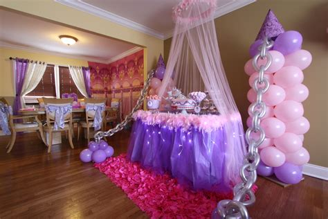 balloon decor by front window and tulle with lights around