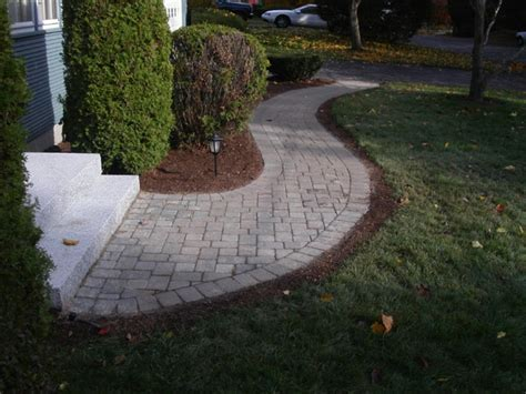 curved sidewalk in front of side entry garage love it other work natural path landscaping