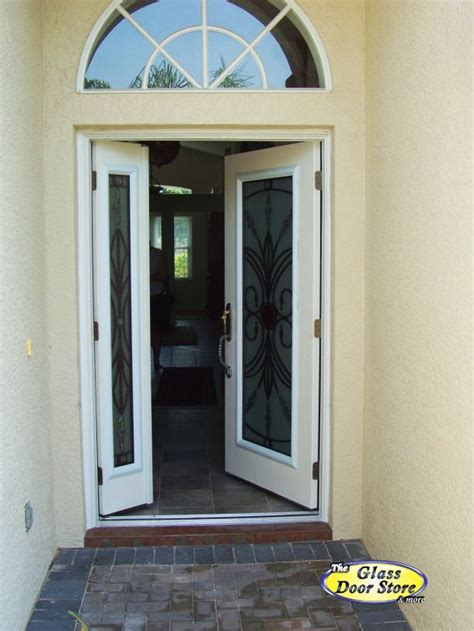 wrought iron front door  opening sidelight  glass