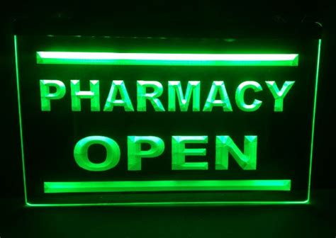 pharmacy drug stores display open  carving signs bar