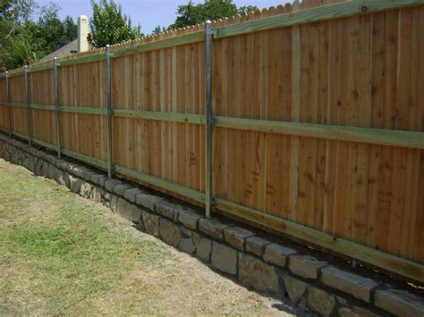 cedar fence on stone retaining wall dallas by circle d industries