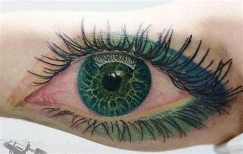 eyeball tattoo green lovely green eye with green makeup tattoo on arm by cris
