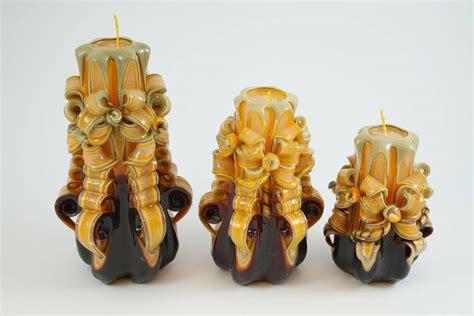 candele intagliate candela intagliata nastro marrone e giallo candele shop