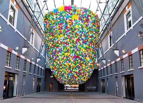 art of recycle enormous beehive made of recycled plastic bags dangles at
