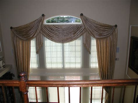 Window treatments for tall windows living room traditional with double height ceiling ethan
