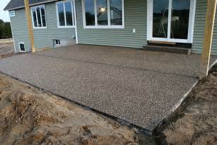 peastone exposed aggregate patio by the concrete artisans