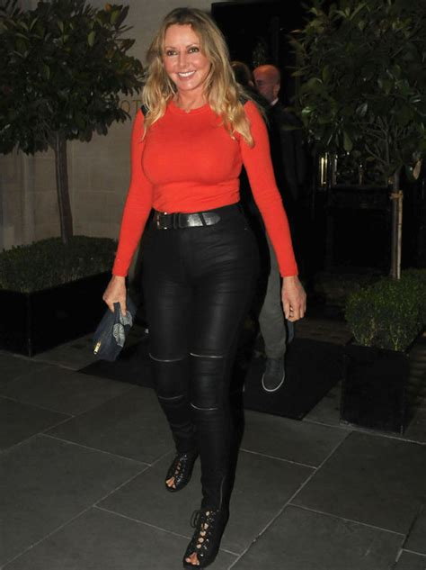 Light Pink Jumpsuit by Carol Vorderman Flaunts Perky Bottom Tight Leather