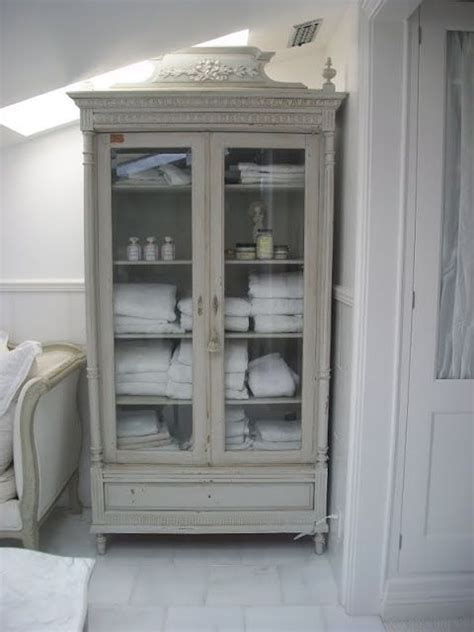 repurposed glass front armoire    storage