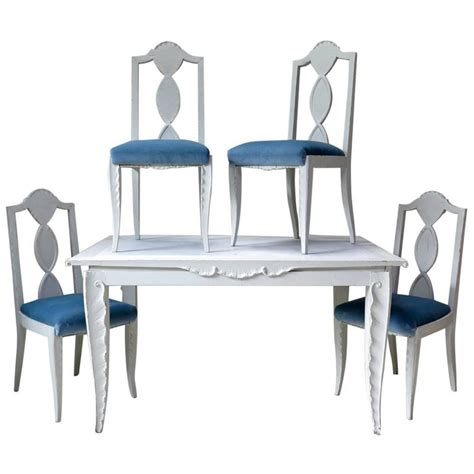 dining table and chairs with carved palm frond motif