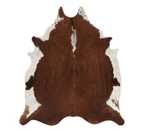 a chandelier and a cow hide rug sew a fine seam cowhide rug pottery barn