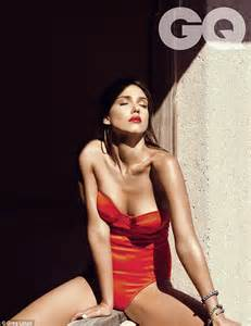 Alba Poses In Gq alba covers up in shimmering dress after