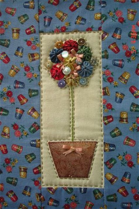 Patchwork Suppliers - yo yo applique wall hanging and topiaries on
