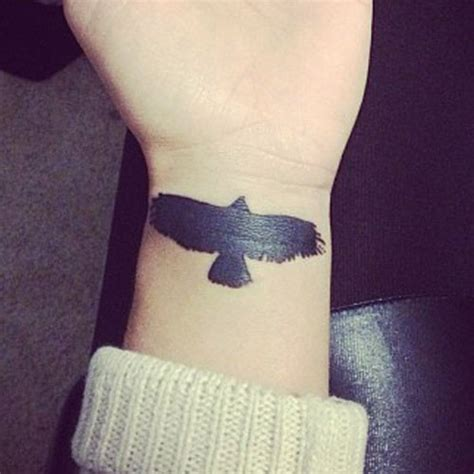 eagle tattoo on wrist black silhouette flying eagle tattoo on forearm by niykee