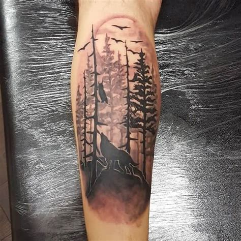black and grey forest tattoo lower arm black and grey flying bird forest tree tattoo