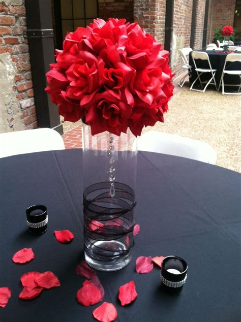 stunning idea for a black and red themed wedding centerpiece with a glass vase decorated in